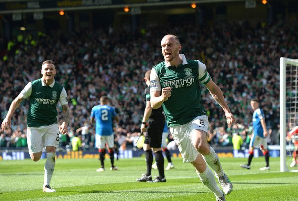 David Gray Photos - David Gray of Hibernian celebrates scoring the winning goal…