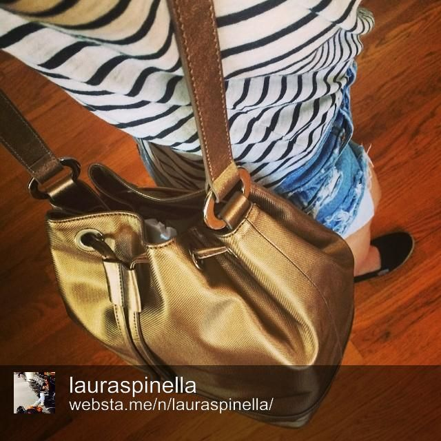 Stylist to the stars, Laura Spinella, with Jill Milan's bucket bag.