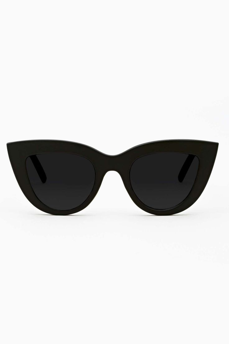 Insanely cute cat-eye shades featuring a matte black frame with gray lenses. UV protection. Looks perfect paired with striped skinnies and stacked bangles! By Quay.