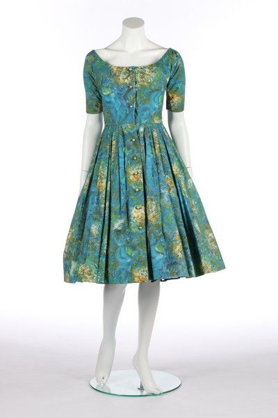 A Claire McCardell by Townley Chagall-print cotton dress, American, circa 1955. labelled, the 'Evening of Enchantment' print with musicians and blossom, blister-pearl buttons - See more at: http://kerrytaylorauctions.com/one-item/?id=122&auctionid=401#sthash.kltDk9iq.dpuf