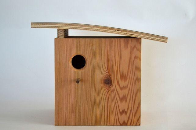 Cedar birdhouse with curved roof