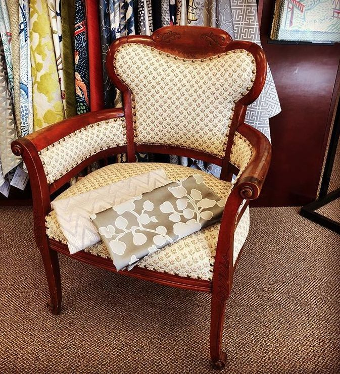 This chair is getting a makeover from Tommy, a talented in-home designer at the Calico Buckhead store. Which Vern Yip fabric do you like best for the inside and which one for the outside? #reupholstery