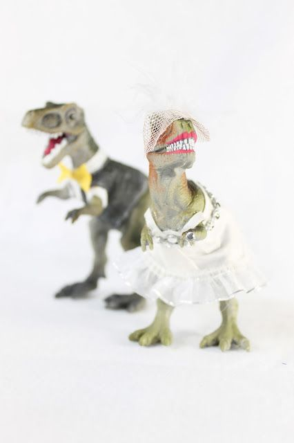 Dinosaur wedding cake toppers. Bride and groom trex,  dressed to match the bride and grooms attire. Theraggedwren.blogspot.com