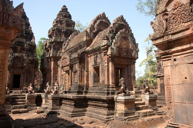 Banteay Srei by Andrea Schaffer on Flickr - Banteay Srei is a 10th-century Cambodian temple dedicated to the Hindu god Shiva. Located in the area of Angkor in Cambodia. It lies near the hill of Phnom Dei, 25 km (16 mi) north-east of the main group of temples that once belonged to the medieval capitals of Yasodharapura and Angkor Thom