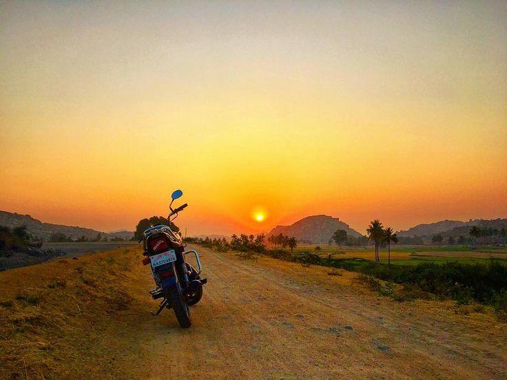 """""""Lagey Aisa Family Jaisa"""" - Hero Honda Splendour >>  #splendour #bike #sun #sunrise #earlymornings #mornings #motorcycle #motorbike #morningsky #earlystart #motorcycles #moto #hampi #sunriseporn #sunrises #traveller #motorrad #motorbikes #sunriselovers #sunrise_sunsets_aroundworld #travellove #biker"""