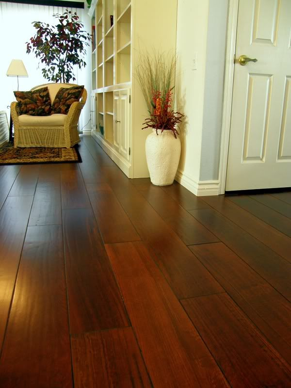 "Chilean Cherry 7"" Plank Low luster engineered wood.  I guess the key to keeping dark wood low maintenance is to have a matte finish."