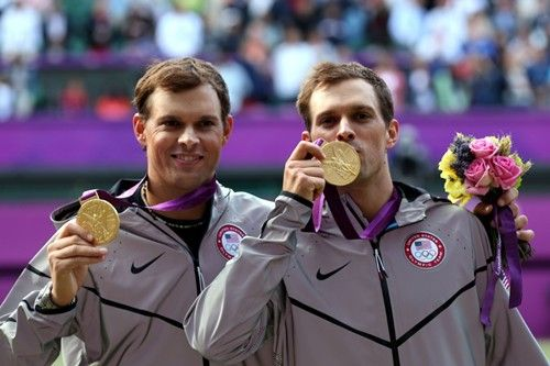 Mike Bryan (L) and Bob #Bryan pose on the podium with their gold medals at the end of the London 2012 #Olympic Games men's doubles #tennis on Day 8 of the London 2012 Olympic Games at the All England Lawn Tennis and Croquet Club on August 4, 2012 in London, England. (Photo by Clive Brunskill/Getty Images)