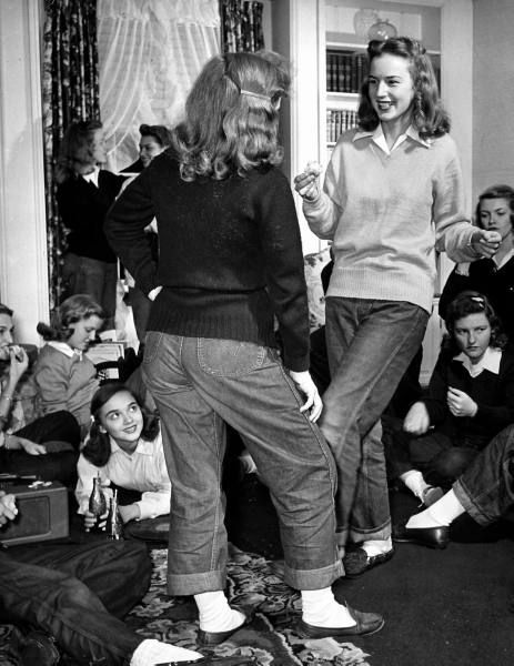 1940s teenaged gals having a blast while sporting comfy casual sweaters, jeans and loafers.