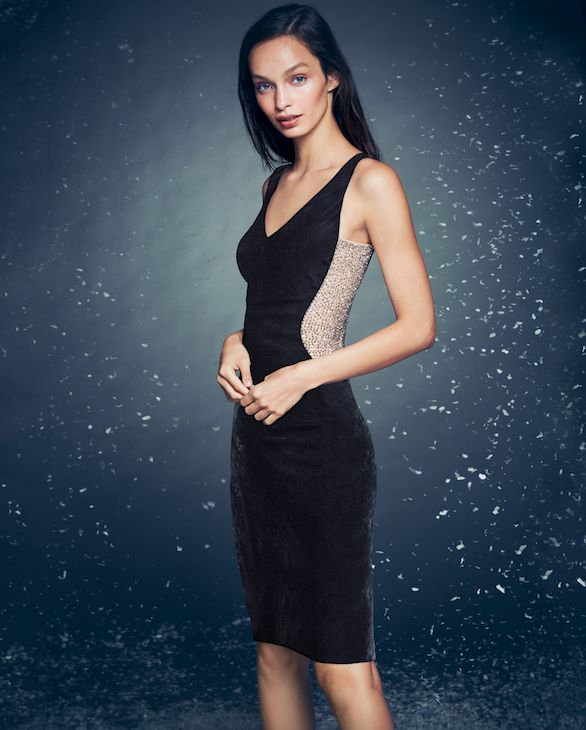 This figure-hugging velvet sheath detailed with embellished mesh dress by Xscape is a Holiday must-have.
