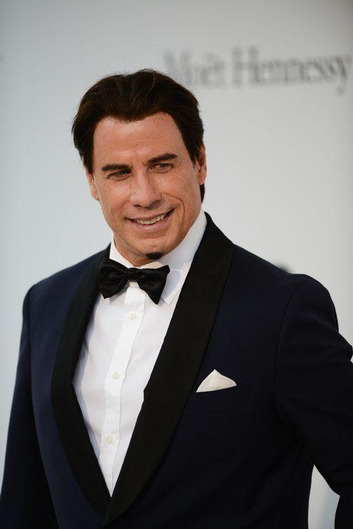 John Travolta lors de la soirée amfAR à Cannes, le 22 mai 2014