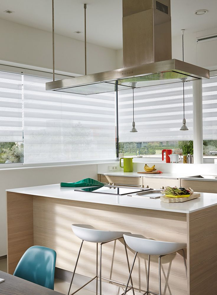 Blinds and soft shades are much more stylish and practical option for kitchens than traditional curtains. They'll give you all the light control and privacy you want and keep your kitchen beautifully insulated. And, if you choose a fabric specially treated with Dustblock®, you'll also have a blind with an antistatic finish which repels moisture and dirt – making it easier to clean and looking good for longer.