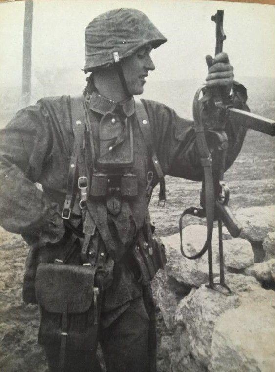 German soldier reloads his 9mm schmeiser submachinegun.