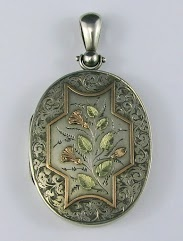 Large Victorian silver locket with rose gold and green gold details