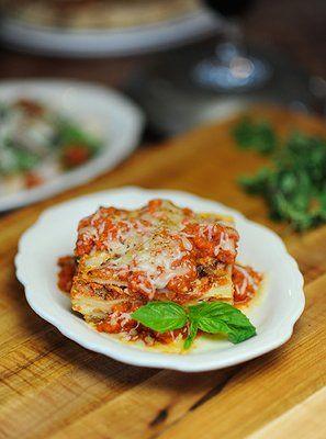 Lasagna with fresh basil garnish