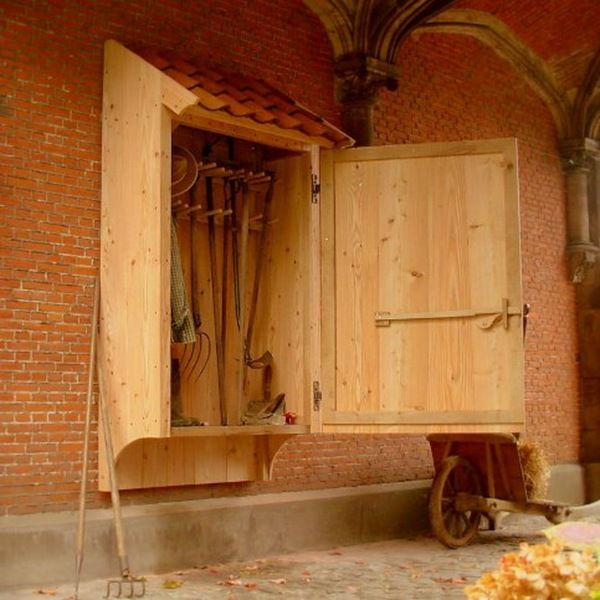 A beautiful garden tool cabinet designed by Dirk Mortier...a master at designing and construction of beautiful farm buildings, fences and accessories, all related to the traditional Flemish country outdoor living and landscape architecture.
