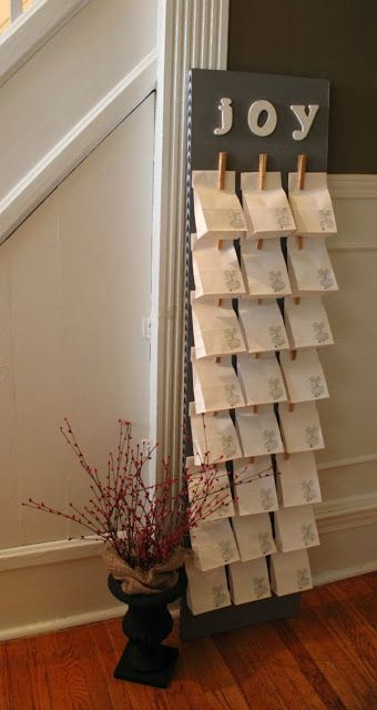 DIY Advent Calendar...big, but I could stuff enough in each bag for each kid and just replenish with lunch bags each year...let the kiddos put the numbers and a bible verse on each bag every year.