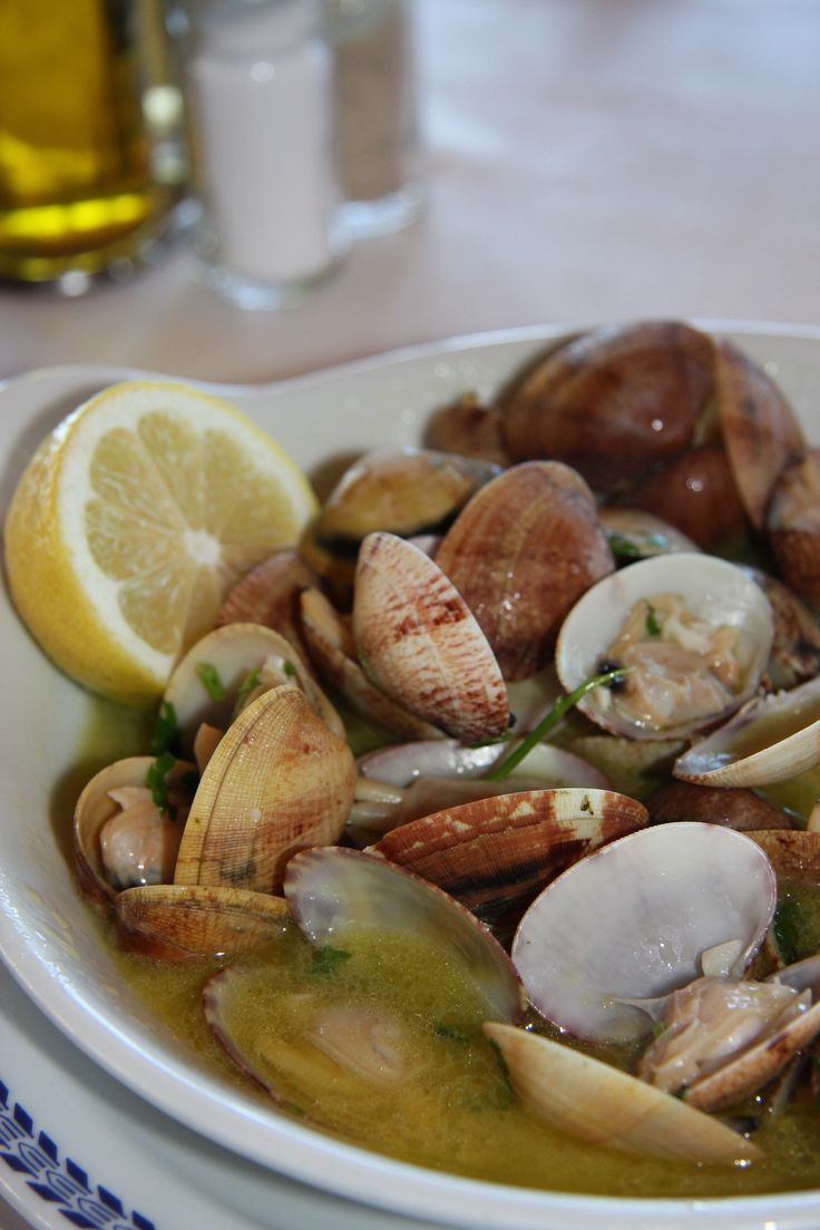 "Portuguese Delights: ""Ameijoas à Bulhão Pato"", Clams with garlic, olive oil, coriander, white wine and lemon juice."
