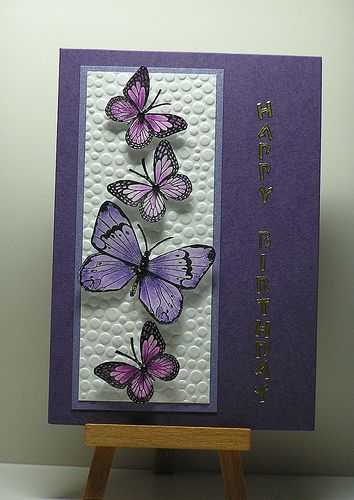 handmade card from Cathys Card Spot: Purple Butterflies ... lovely arrangement of stamped, cut out and popped up butterflies and a embossing folder texture block ...