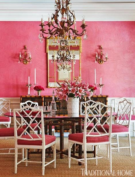 Designer Robin Weiss and husband Bill's Palm Beach vacation home is filled with raspberry hues, via Traditional Home.