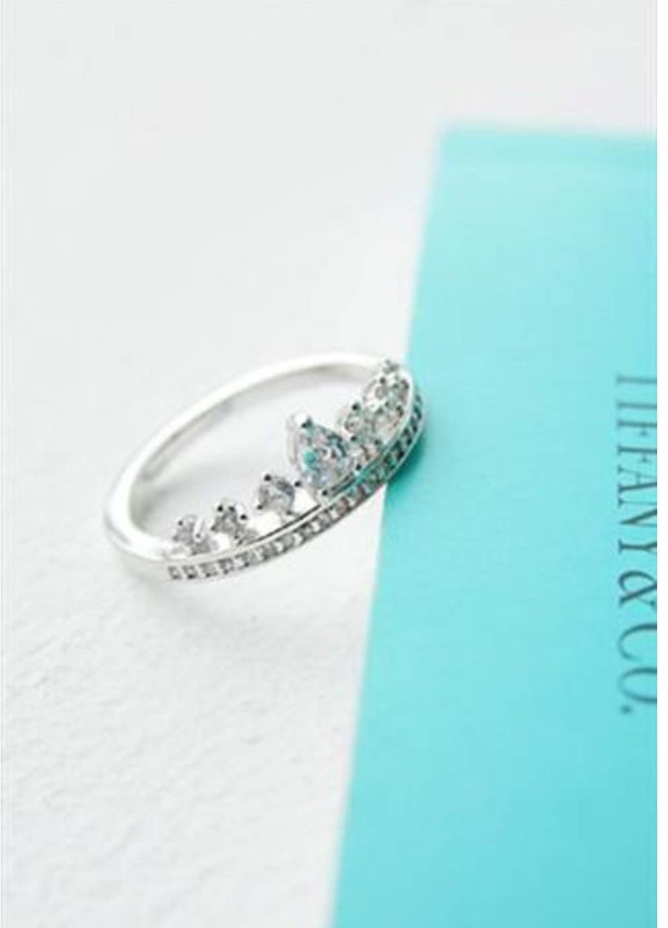 The Tiffany & Co. crown ring! It's a bit like an Irish wedding ring. Image…