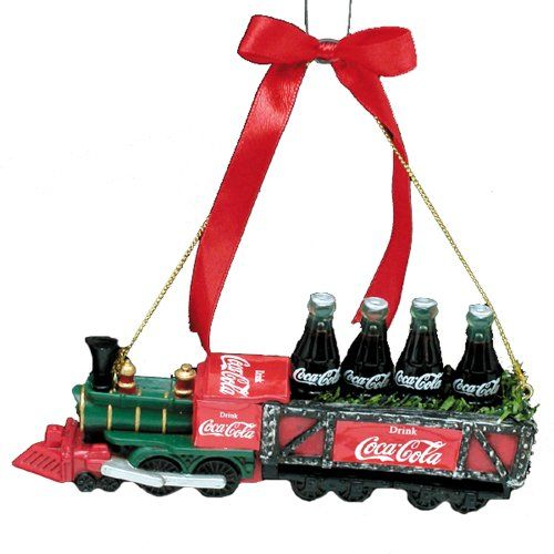 A perfect decor piece for the holiday, this Coca-Cola train is decked out in red and green with classic Coca-Cola bottles.
