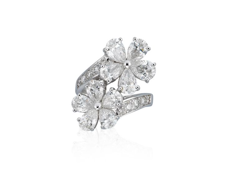 BULGARI DIAMOND RINGOf crossover design, each terminal designed as a pear shape diamond flowerheadMetal: 18K white goldDiamonds: 10 pear and 10 round diamonds weighing approximately 3.90-4.20 carats totalSize/Dimensions: US ring size 4¾Signature: Bulgari (indistinct), no.6102Marks: 750, Made in ItalyBox: Black leather Bulgari caseClick here for Measurment ChartClick here for Diamonds The 4 C's