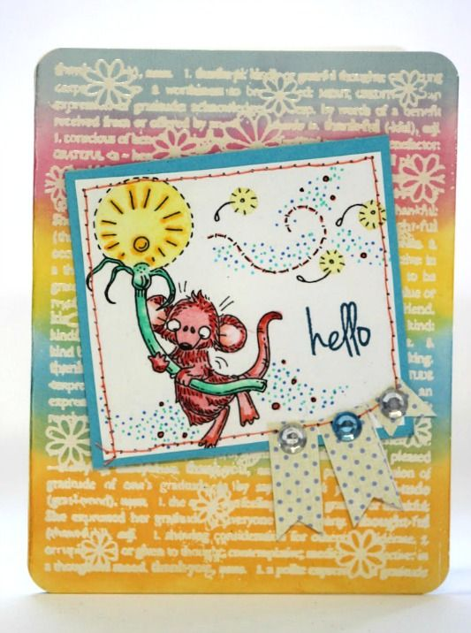 This is a digital stamp coloured with markers, the background is heat embossed and coloured with distress inks.