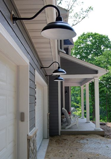 Classic black RLM lights offer a neutral outdoor lighting solution on this traditional country home.