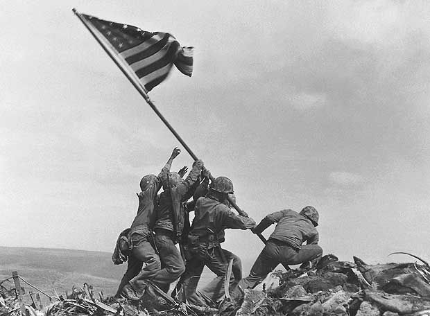 Joseph John Rosenthal  U.S. Marines of the 28th Regiment of the Fifth Division raise the American flag atop Mt. Suribachi, Iwo Jima, on February 23, 1945. The Battle of Iwo Jima was the costliest in Marine Corps history, with almost 7,000 Americans killed in 36 days of fighting.