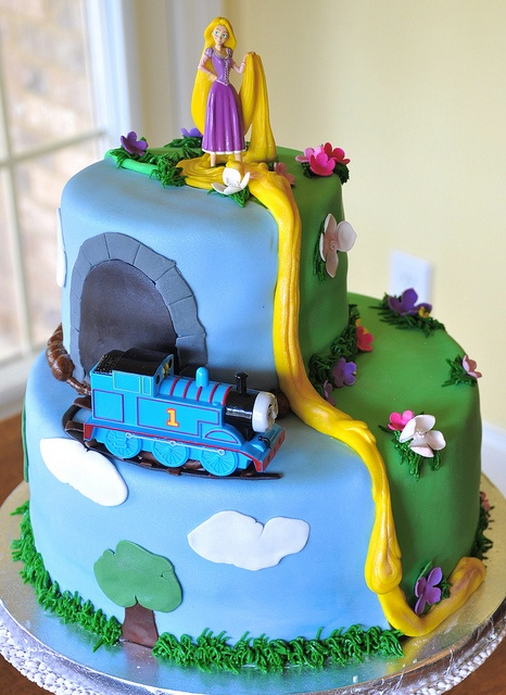 Thomas the train and Tangled cake - love the color! for boy - girl bday I need to do something like this for our next party!