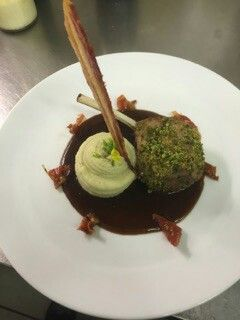 Herb crusted rack of lamb.hay smoked pomme puree.. rosemary and mint red wine jus