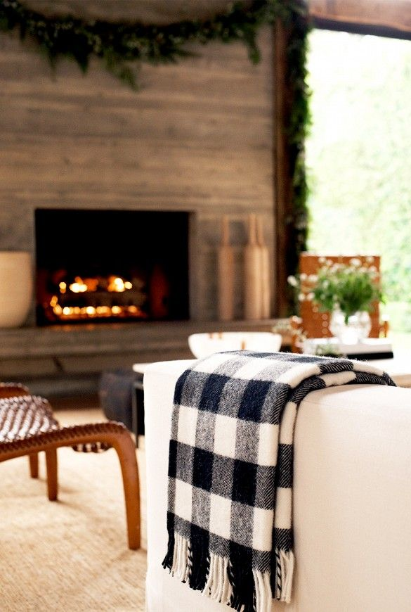 Sofa detail with cozy plaid throw