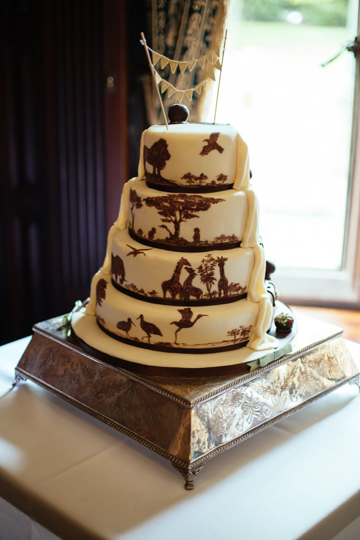 White and milk chocolate cake. Perfect for a wedding held at a zoo!  Photo by Liz Wan Photography