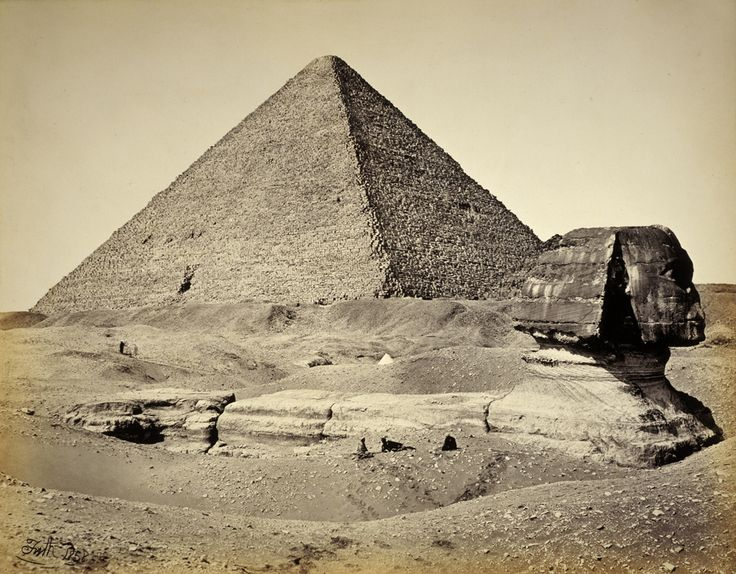 The Sphinx of Giza, partially excavated, with two pyramids in background, Egypt, 1867-1899