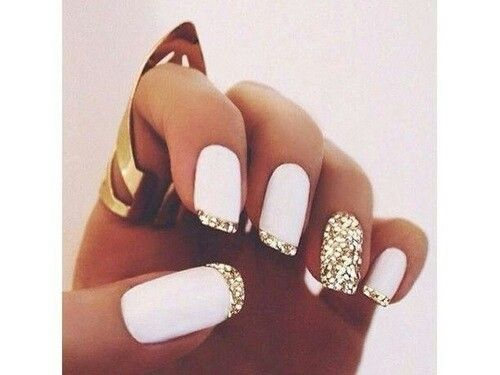 White nails with gold accents                                                                                                                                                                                 More