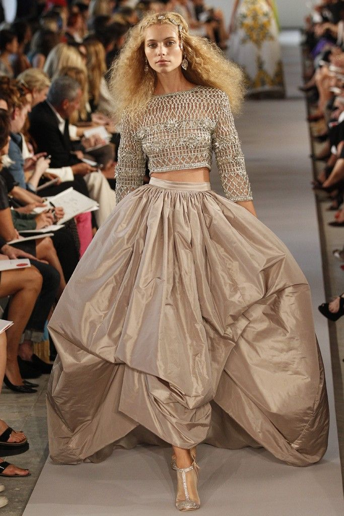Oscar de la Renta- I love the hair and accessories for a wedding. I also like the color of the dress and top for a wedding. I think this is cute, maybe even for a nontraditional wedding, except I would not want the exposed stomach, so I'd want a longer top like this.