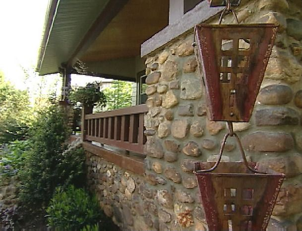 See how much a copper rain chain downspout adds a unique touch to this Craftsman style home renovation that was featured on HGTV Curb Appeal.
