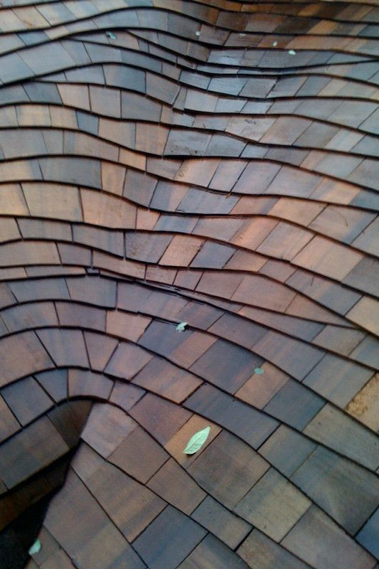 Newly Installed Wood Shingle Thatch Roof With A
