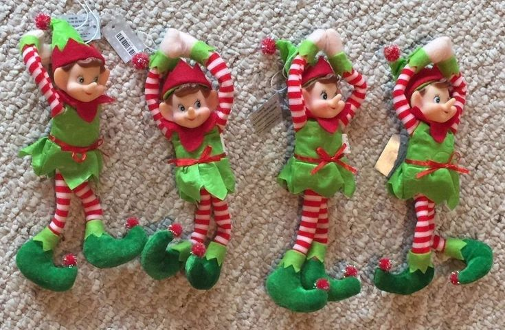 Lot of 4 Plush Elves/Pixie Dolls, light wire in arms and legs allow them to sit independently (they are posable), Plush with plastic faces, with white thread to hang as Christmas Ornaments. With velcro on hands (to help pose/hang/wrap them).  Elves are wearing chartreuse/lime green outfits, with red and white and dark green accents. All look snappy in their holiday best!  Brand new with tags.   Very sweet and cute. Beautiful happy blue eyes.