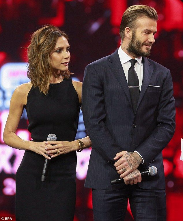 Sharing the stage: Victoria and David Beckham put a rare dual appearance on Thursday in China