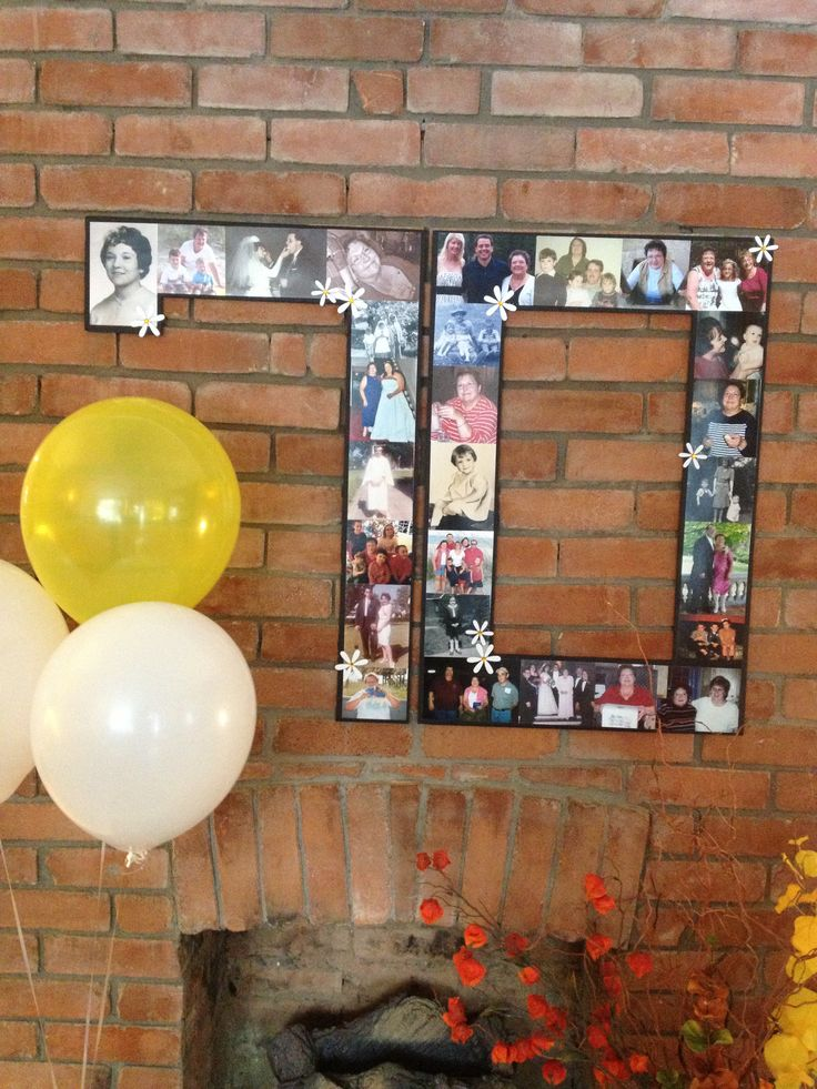 Photo display at mom 39 s 70th birthday party mom 39 s 70th for 70 birthday decoration ideas