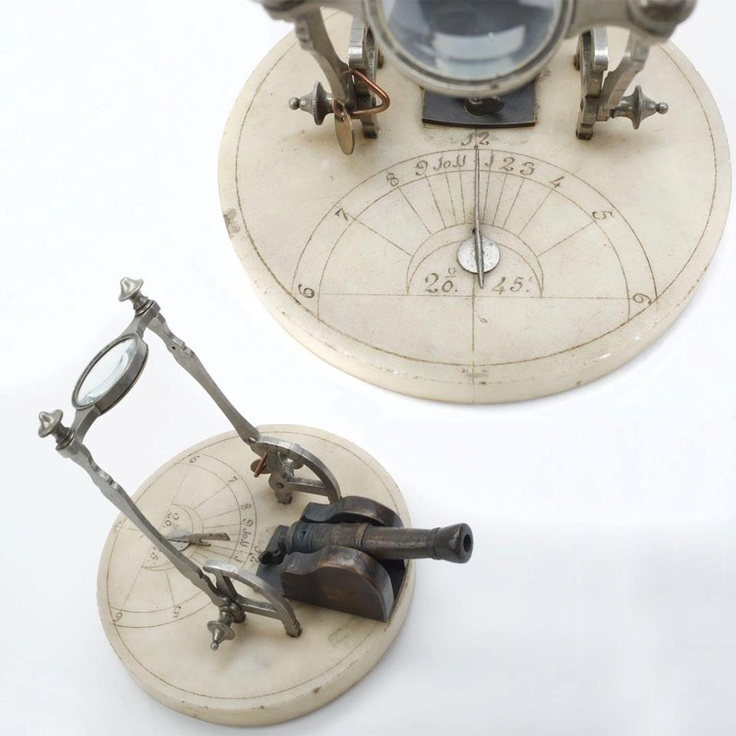 SUNDIAL CANNON: This curious time piece is an excellent example of the now scarce sundial guns. The variant pictured is of marble, brass and glass construction dating from approximately 1850. The cannon is a brass miniature fixture with a .30 caliber bore.Sundial Cannon, Guns Stuff, Brass Minis, Caliber Bored, 1850, Sundial Guns, Dating, Brass Miniatures, Glasses Construction