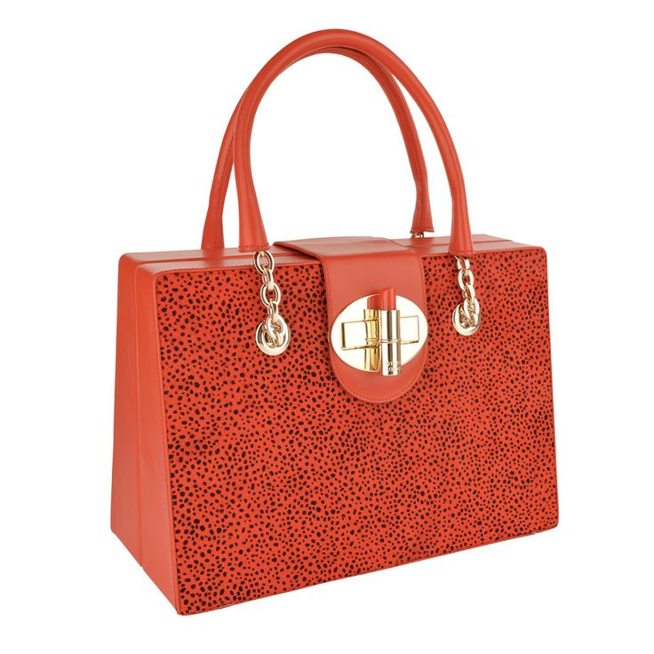 Stylish trunk design made of a combination of leopard printed hair on hide and smooth Red Napa leather, finished with the signature OYSBY lipstick clasp closure.