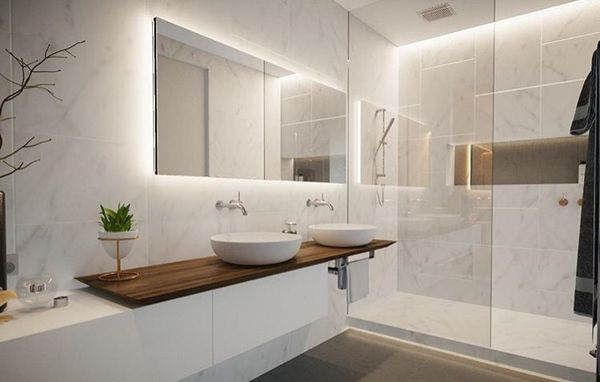 Like the big FLAT mirror on the wall with lighting strips on top and bottom across the room (B1)