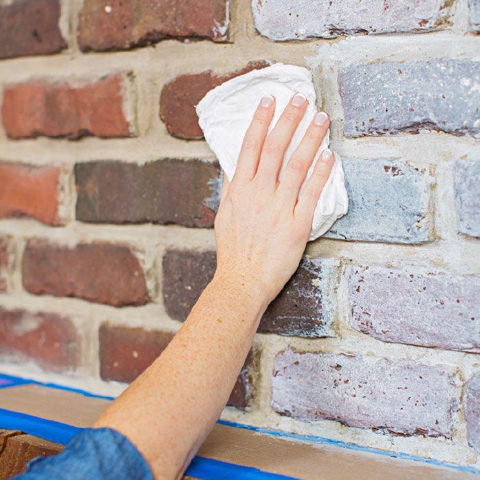 Lighten up a traditional fireplace with an easy-to-apply wash of inexpensive paint.