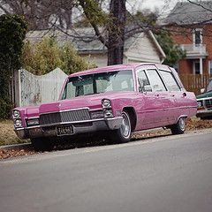 Pink Hearse .  A litttle too big for all that pink.  'In The Pink' would be a good carname for this.