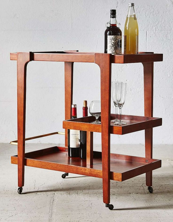 Don Draper would totally go for this mid-century modern bar cart, and maybe an old-fashioned.