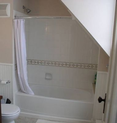 Shower Curtain / Door Ideas?-curved-shower-rod-shower-sloped-wall.jpg
