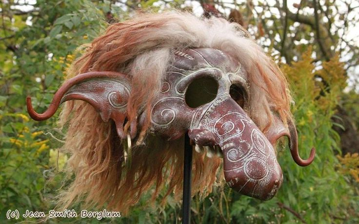Gisli the Olden Troll - The troll mask is 100 % hand-made and hand-shaped of vegetable tanned leather. The other materials are grain color, acrylic paint, cow teeth, butyric acid tanned sheepskin and brass rings in the ears.