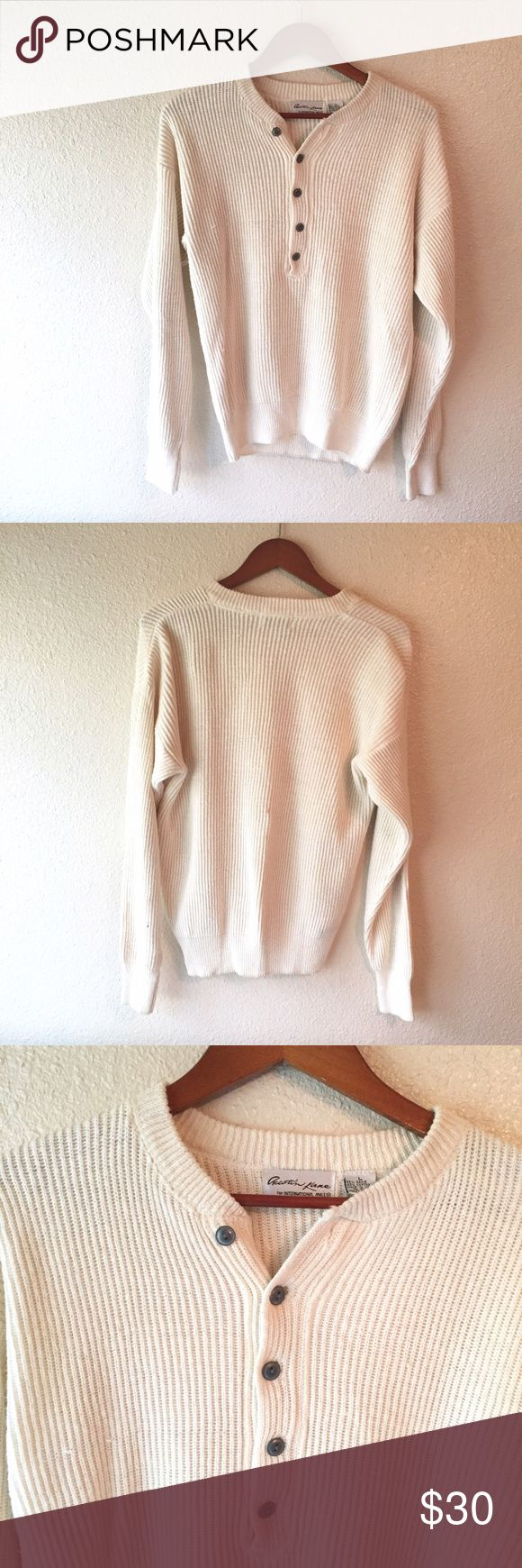 Vintage Austin Kane thick knit Henley sweater L Austin Kane brand. Size large. Very handsome shirt that is made of nice thick Knit material. Creamy white color with gray buttons. Really shows off muscles! There is a small dot on the back that I have shown a photo of. In otherwise good used condition. Vintage sweater! Vintage Sweaters